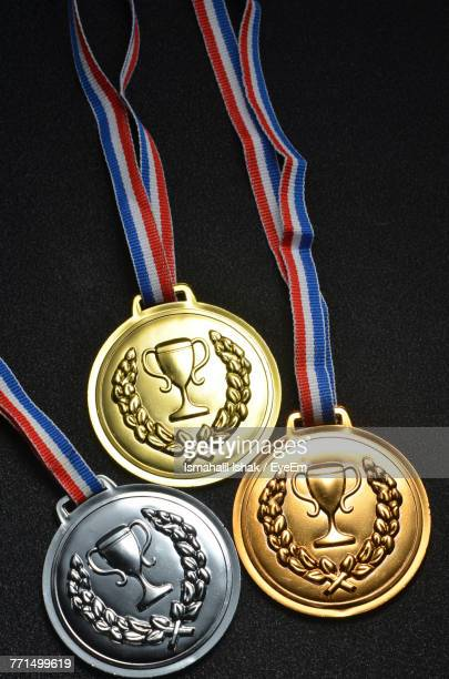 close-up of medals on black table - メダル ストックフォトと画像