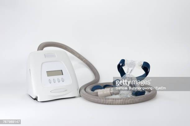close-up of medical oxygen equipment against white background - respiratory machine stock photos and pictures