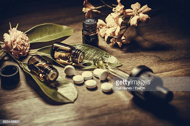 Close-Up Of Medicines And Herbs On Table