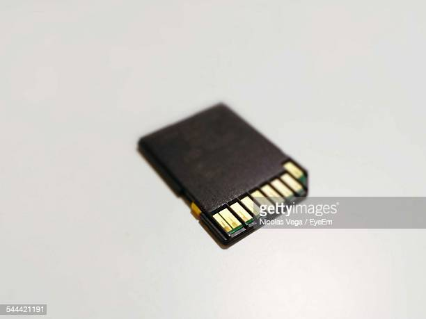 Close-Up Of Memory Card Over White Background