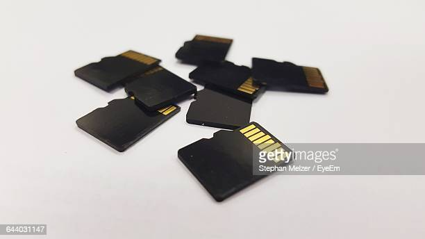 Close-Up Of Memory Cards On White Background