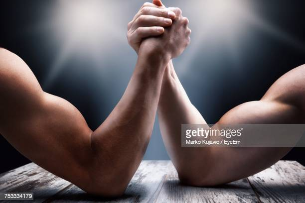 Close-Up Of Men Arm Wrestling