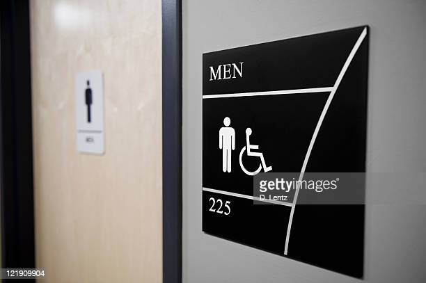 Close-up of Men's restroom sign