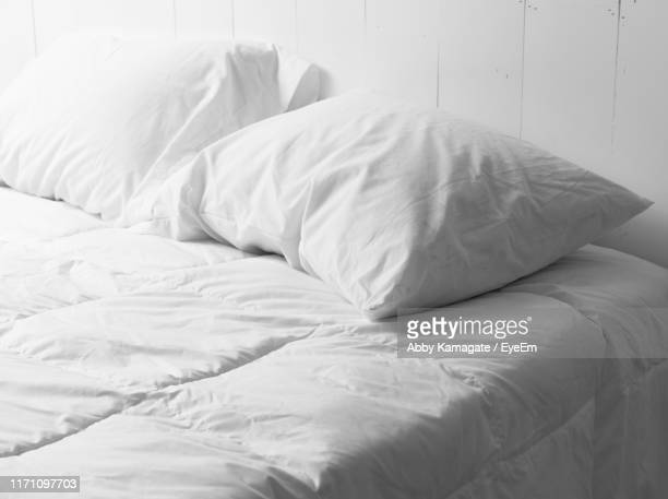close-up of messy bed - pillow stock pictures, royalty-free photos & images