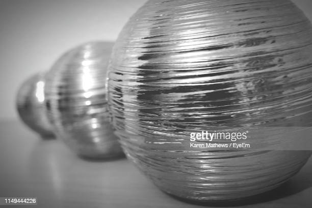 Close-Up Of Metal Balls Over Gray Background