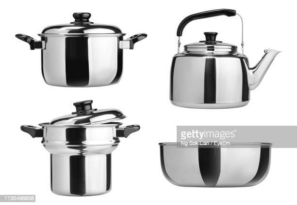 close-up of metal containers against white background - tiffin box photos et images de collection
