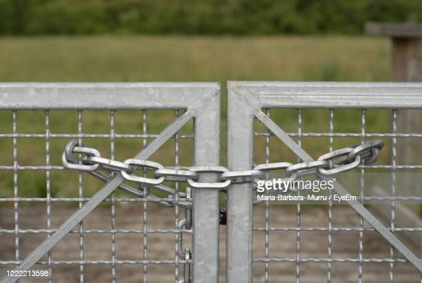close-up of metal fence, closed with a chain - treviso italy stock pictures, royalty-free photos & images