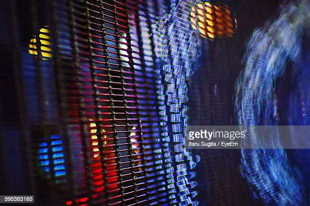 close-up of metal grate at night - metal grate stock photos and pictures