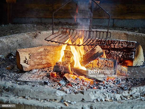 close-up of metal grate in fire pit - teemu tretjakov stock pictures, royalty-free photos & images