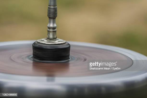 Close-Up Of Metal Object Spinning