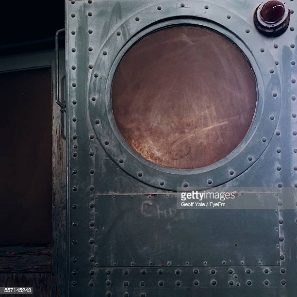 close-up of metal ship door - porthole stock photos and pictures