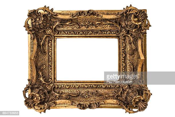 close-up of metallic frame against white background - ornate stock pictures, royalty-free photos & images