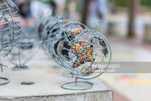 close-up of metallic globe on table - map of africa stock photos and pictures