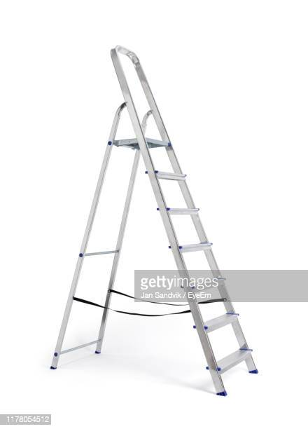 close-up of metallic ladder against white background - step ladder stock photos and pictures