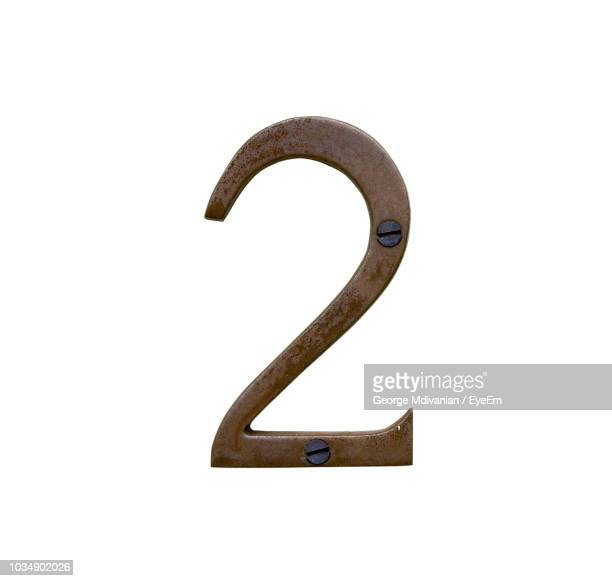 close-up of metallic number over white background - number 2 stock pictures, royalty-free photos & images