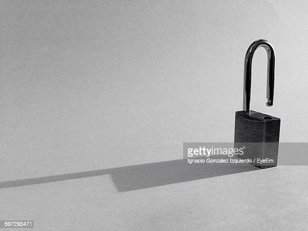Close-Up Of Metallic Padlock With Shadow On White Background