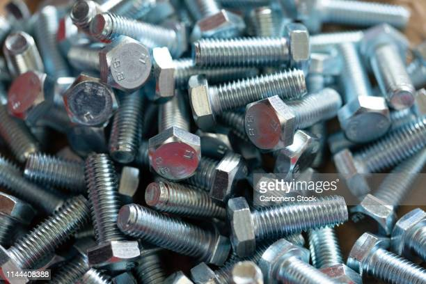 close-up of metallic screws - spare part stock pictures, royalty-free photos & images