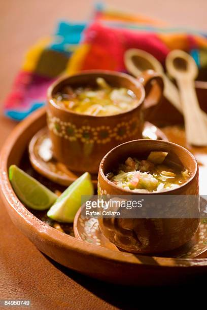 close-up of mexican chicken broth in cups - saucer stock pictures, royalty-free photos & images