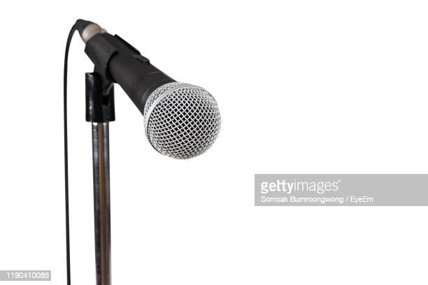 close-up of microphone against white background - microphone stock pictures, royalty-free photos & images