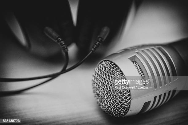 Close-Up Of Microphone And Headphones On Table