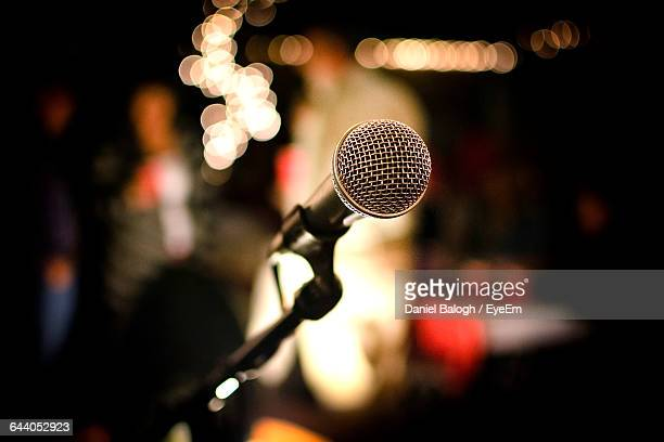 close-up of microphone at nightclub - microphone stand stock photos and pictures