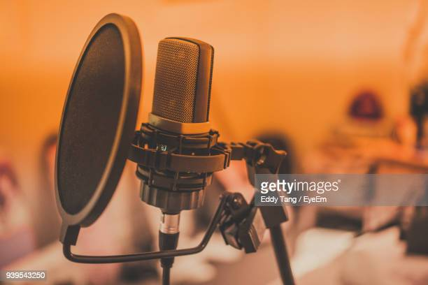 close-up of microphone in recording studio - recording studio stock pictures, royalty-free photos & images