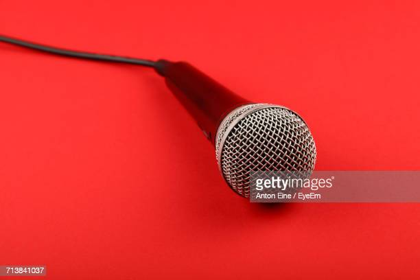 Close-Up Of Microphone On Red Background