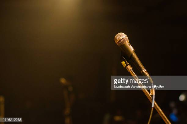 close-up of microphone on stand in nightclub - microphone stand stock photos and pictures