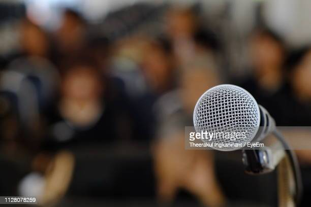 close-up of microphone - incidental people stock pictures, royalty-free photos & images