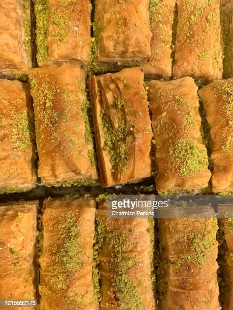 closeup of middle eastern sweets, pistachio baklava with honey, pastry and nuts to celebrate eid al fitr - レバノン共和国 ストックフォトと画像