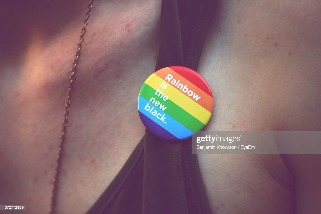 Close-Up Of Midsection Of Man Wearing Rainbow Badge With Message : Stock Photo