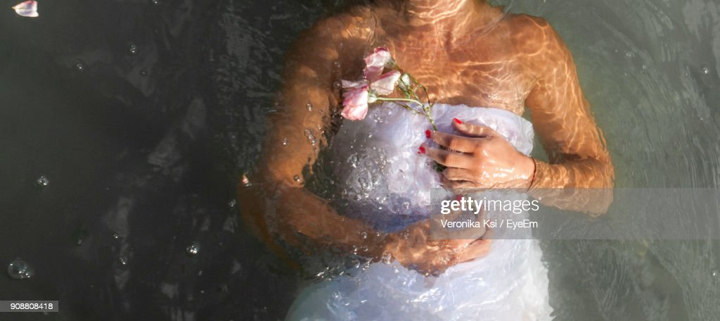 Close-Up Of Midsection Woman Underwater : Stock Photo