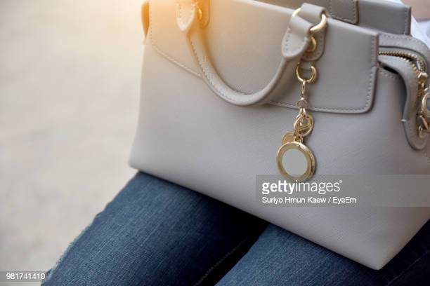 close-up of midsection woman with purse lap - gold purse stock pictures, royalty-free photos & images