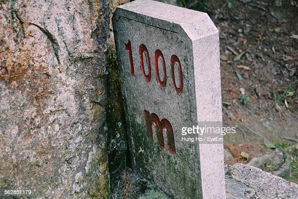 Close-Up Of Milestone By Rock