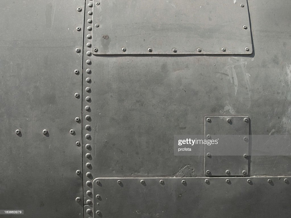 Close-up of military detail in a dark gray color : Stock Photo