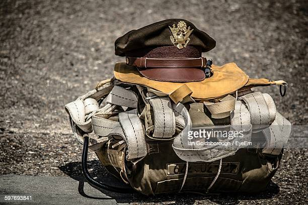 close-up of military uniform with peaked cap on road - uniform cap stock pictures, royalty-free photos & images