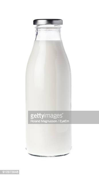 close-up of milk bottle on white background - milk bottle stock pictures, royalty-free photos & images