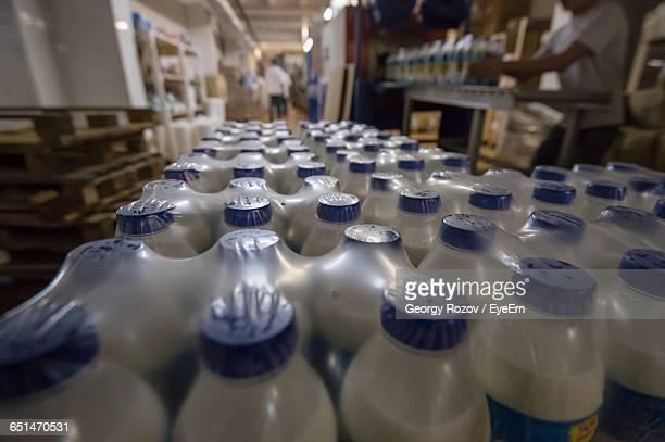 Close-Up Of Milk Bottles At Dairy Plant