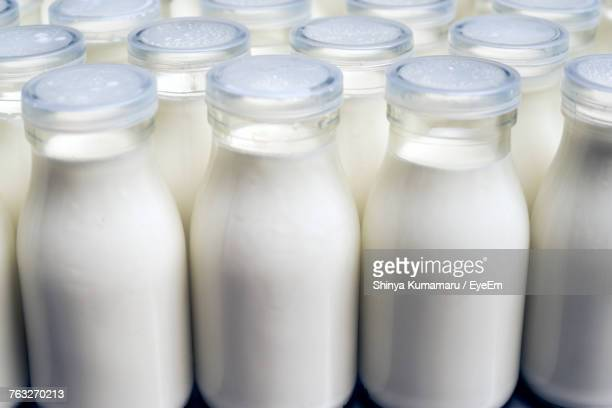 close-up of milk bottles - milk bottle stock pictures, royalty-free photos & images