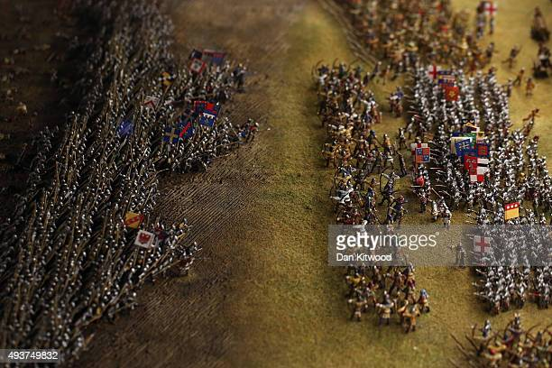 A closeup of miniature figures taking part in the Battle of Agincourt containing over 40000 scale model figures on a detailed diorama of the...