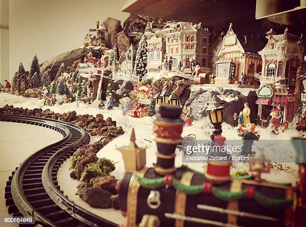 Close-Up Of Miniature Train With Toys