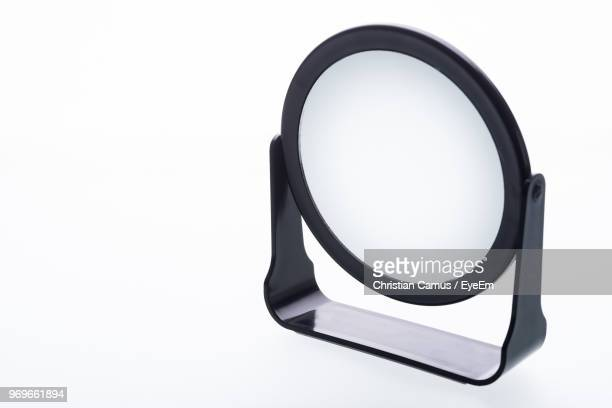 close-up of mirror against white background - mirror object stock pictures, royalty-free photos & images