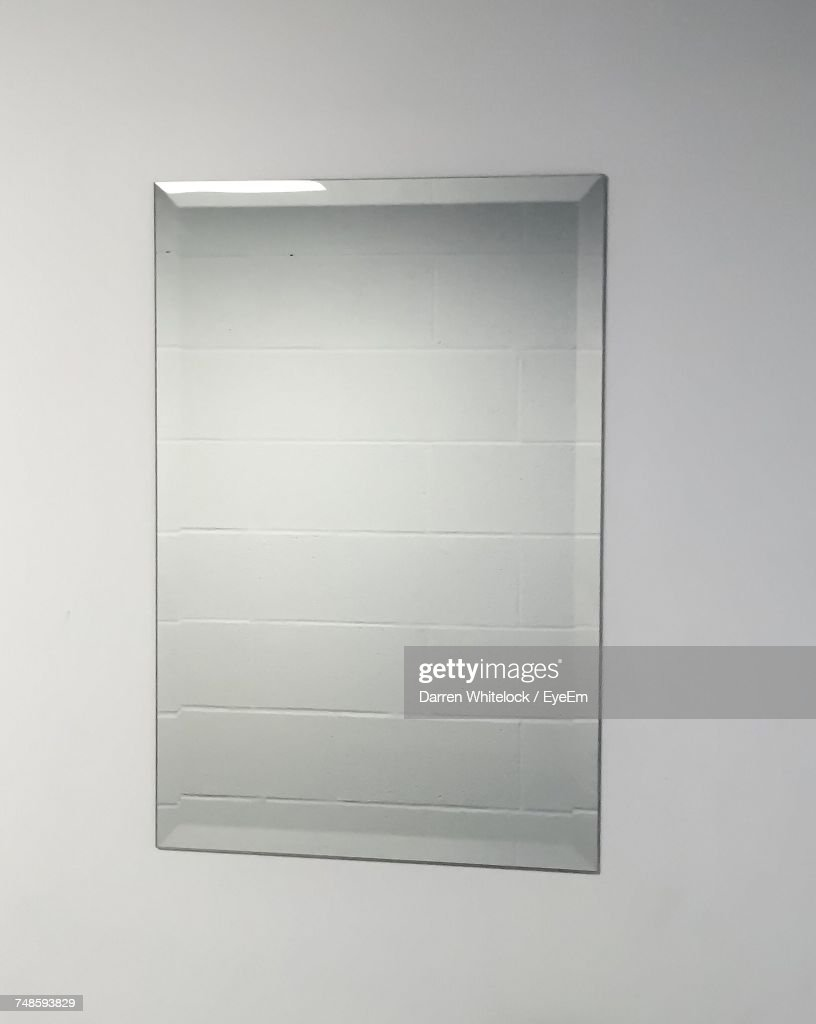Close-Up Of Mirror On Wall : Stock Photo