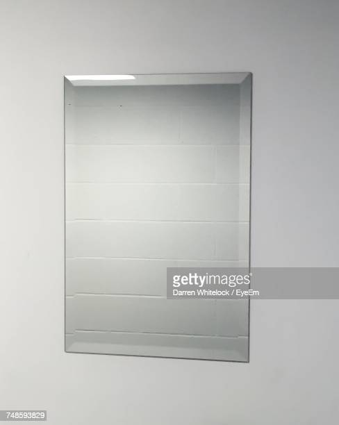 close-up of mirror on wall - mirror stock photos and pictures