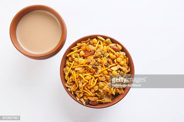 close-up of mixture snack with tea - indian food stock pictures, royalty-free photos & images