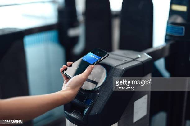 close-up of mobile contactless payment - merchandise stock pictures, royalty-free photos & images