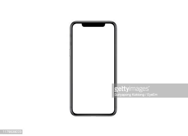 close-up of mobile phone against white background - smart phone stock pictures, royalty-free photos & images