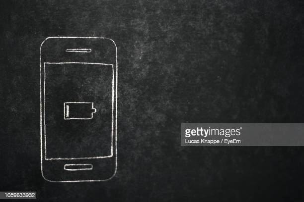 close-up of mobile phone drawing on blackboard - chalk wall stock pictures, royalty-free photos & images