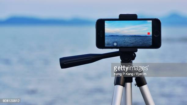 close-up of mobile phone on tripod - tripod stock pictures, royalty-free photos & images
