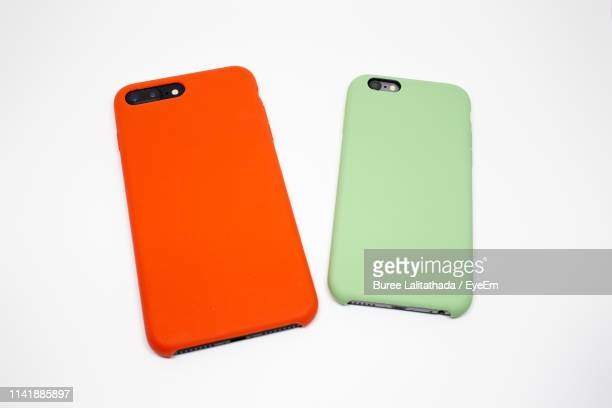 close-up of mobile phones with covers over white background - phone cover stock pictures, royalty-free photos & images